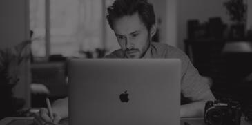man using mac laptop