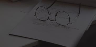 Glasses sitting on notebook - ACBM blog